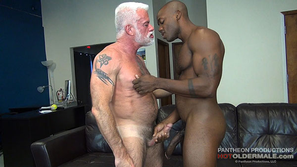 Hard skinny gay man puffs on an erect penis